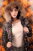 istock Beautiful woman wearing winter jacket under snowfall 1015247462