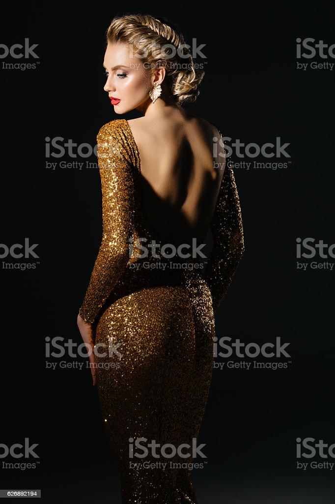 Beautiful woman wearing yellow dress stock photo
