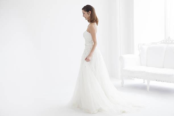 beautiful woman wears a wedding dress. - brautstyling stock-fotos und bilder