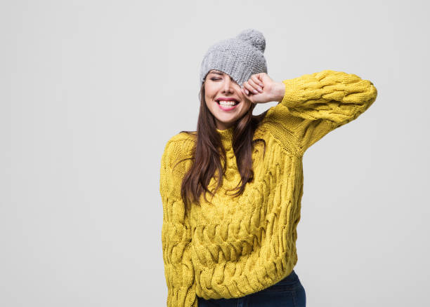 Beautiful woman winter portrait Beautiful joyful girl is laughing and having fun. Studio shot. Isolated on gray background sweater stock pictures, royalty-free photos & images