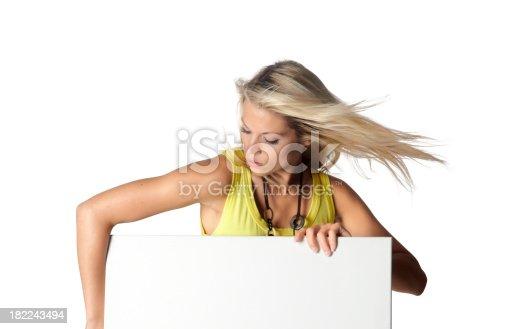 157609352 istock photo beautiful woman with a billboard 182243494