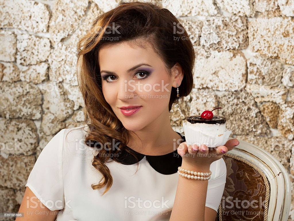 Beautiful woman with a cake stock photo