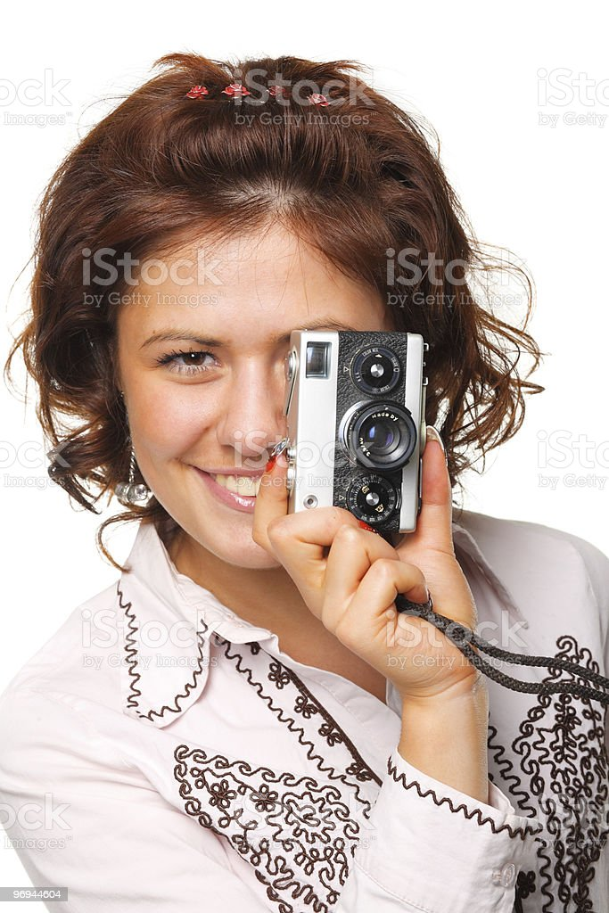 Beautiful woman with a camera royalty-free stock photo
