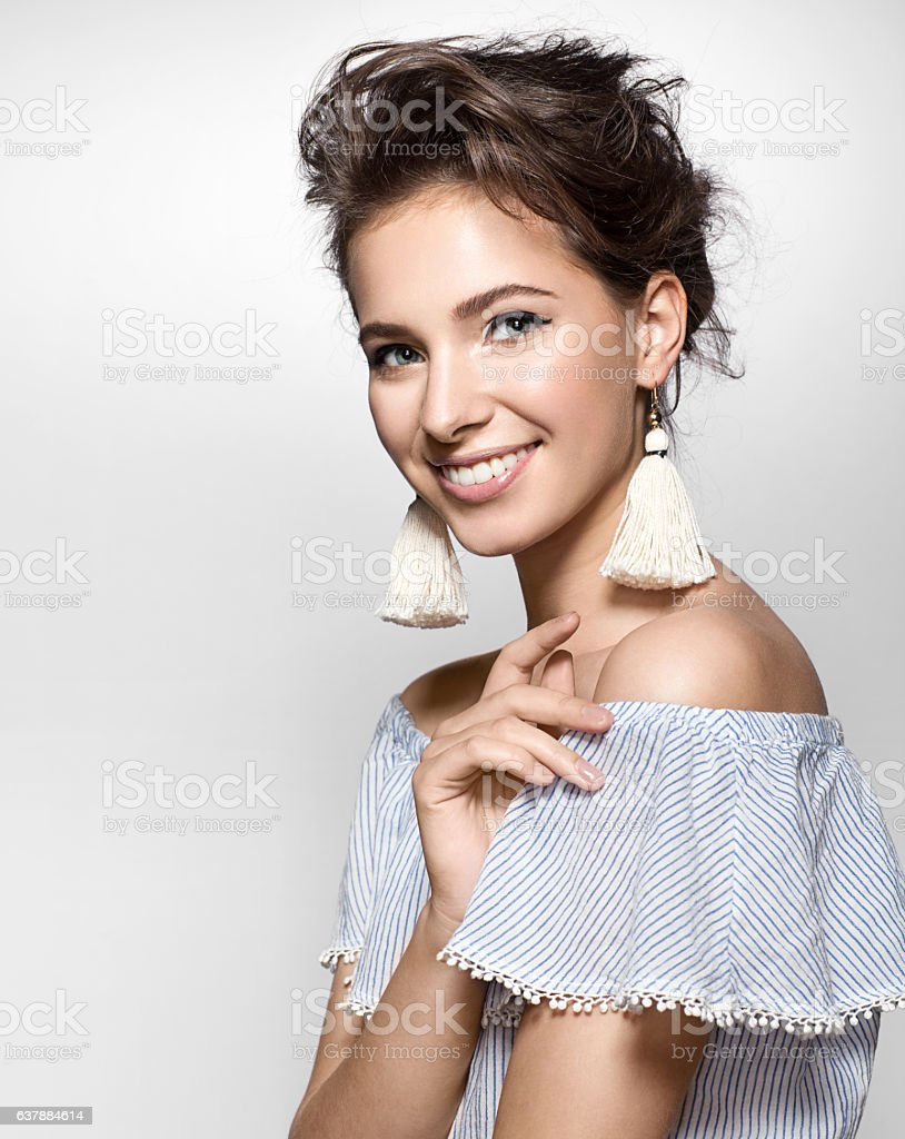 Beautiful woman with a charming smile in a summer dress - foto de acervo
