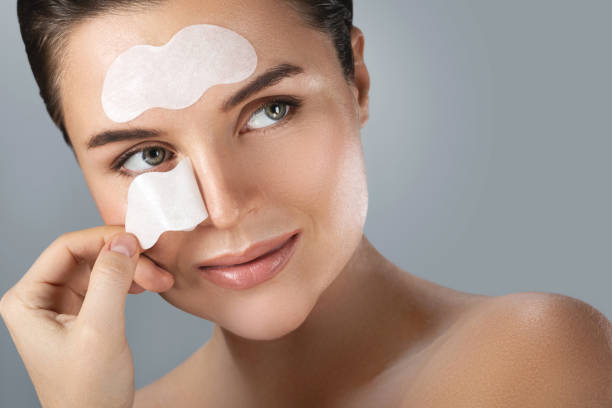 Beautiful woman with a cleansing pore strips on her face stock photo