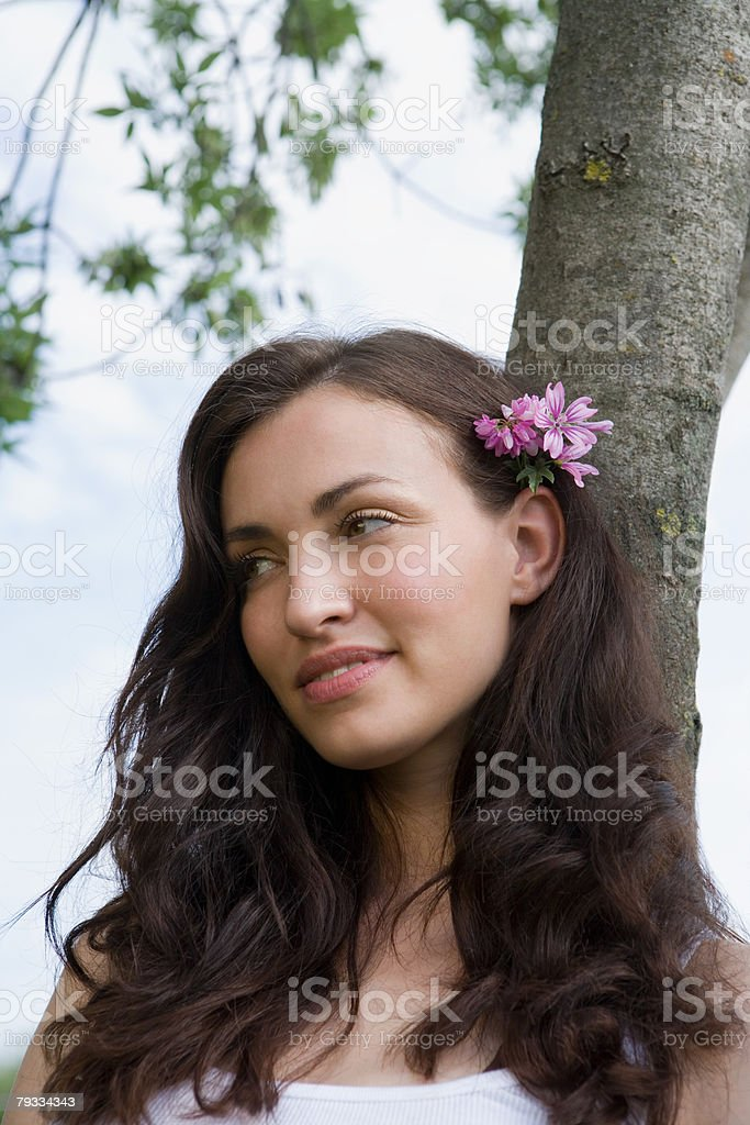 Beautiful woman with a flower in her hair 免版稅 stock photo