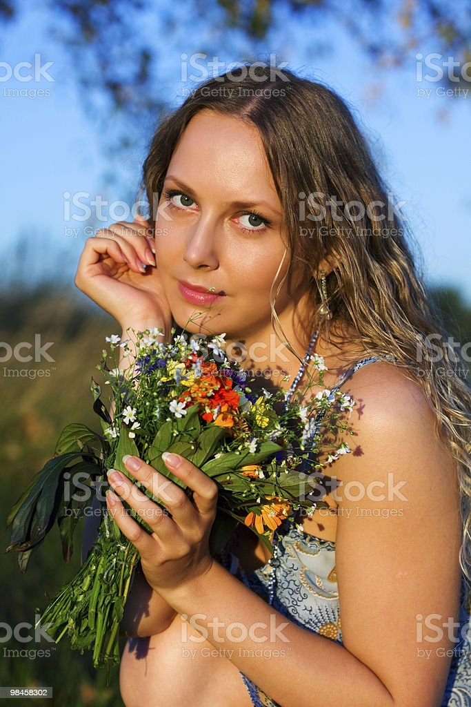 Beautiful woman with a flowers royalty-free stock photo