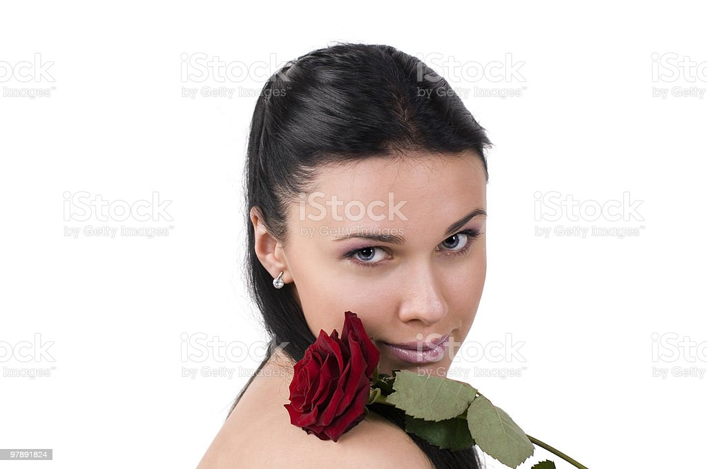 Beautiful woman  with a  rose on the bared shoulder. royalty-free stock photo
