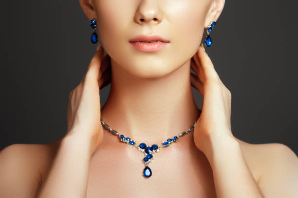 beautiful woman with a sapphire necklace. fashion concept - sapphire gemstone stock photos and pictures