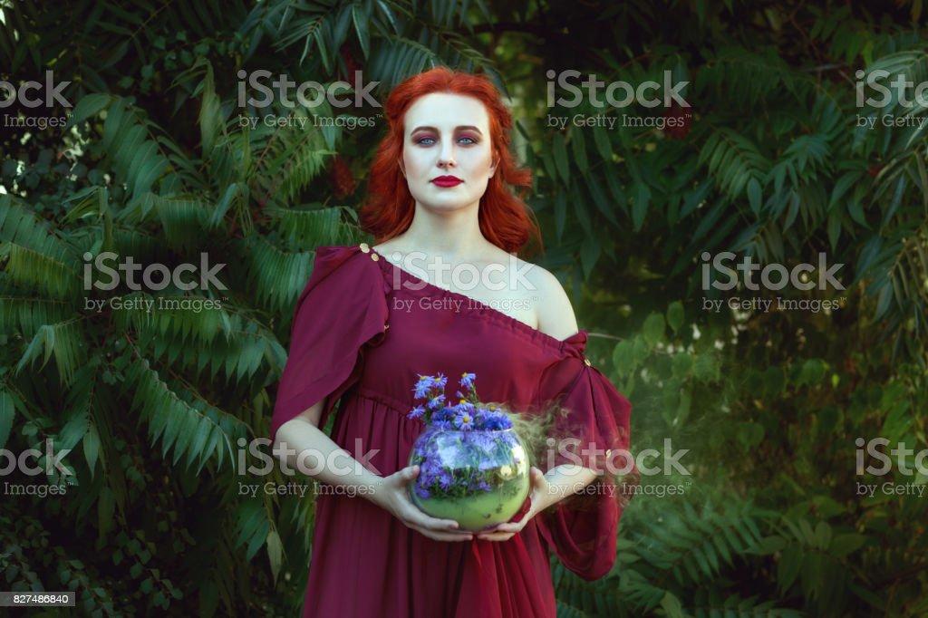 Beautiful woman with a shaman. stock photo
