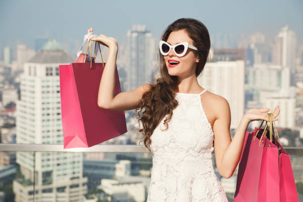 beautiful woman with a shopping bags in the big and modern city - spending money stock photos and pictures