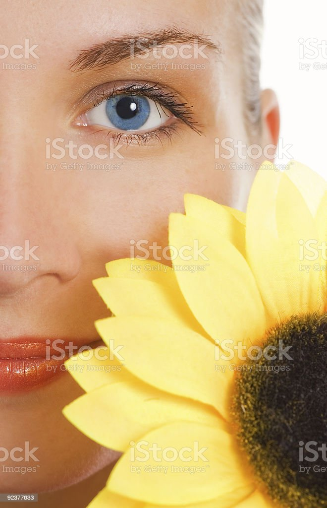 Beautiful woman with a sunflower royalty-free stock photo
