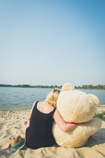 505935220 istock photo Beautiful woman with a teddy bear 487951316