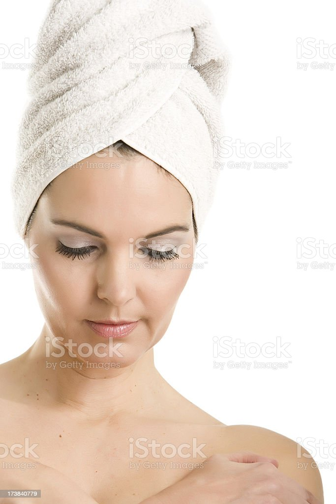Beautiful woman with a towel on her head stock photo