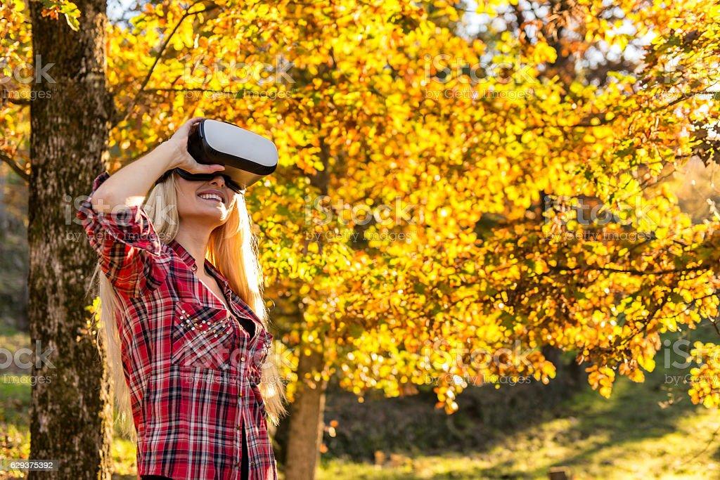 Beautiful woman with a virtual reality simulator stock photo