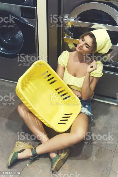 Beautiful woman with a yellow basket sitting on the floor in laundry picture id1190021184?b=1&k=6&m=1190021184&s=612x612&h=pzkbnjn3djgi7dxyfhkhf2rclzaqfoxvc230jd7og g=