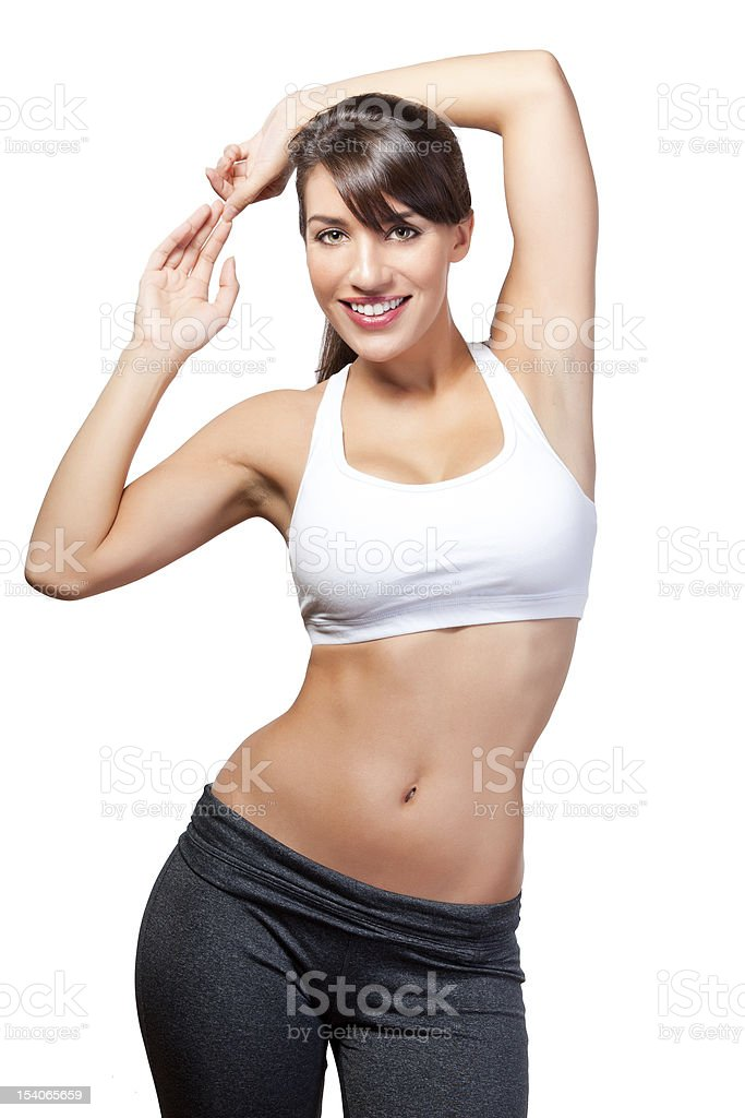 Beautiful woman with abs posing in workout clothes royalty-free stock photo