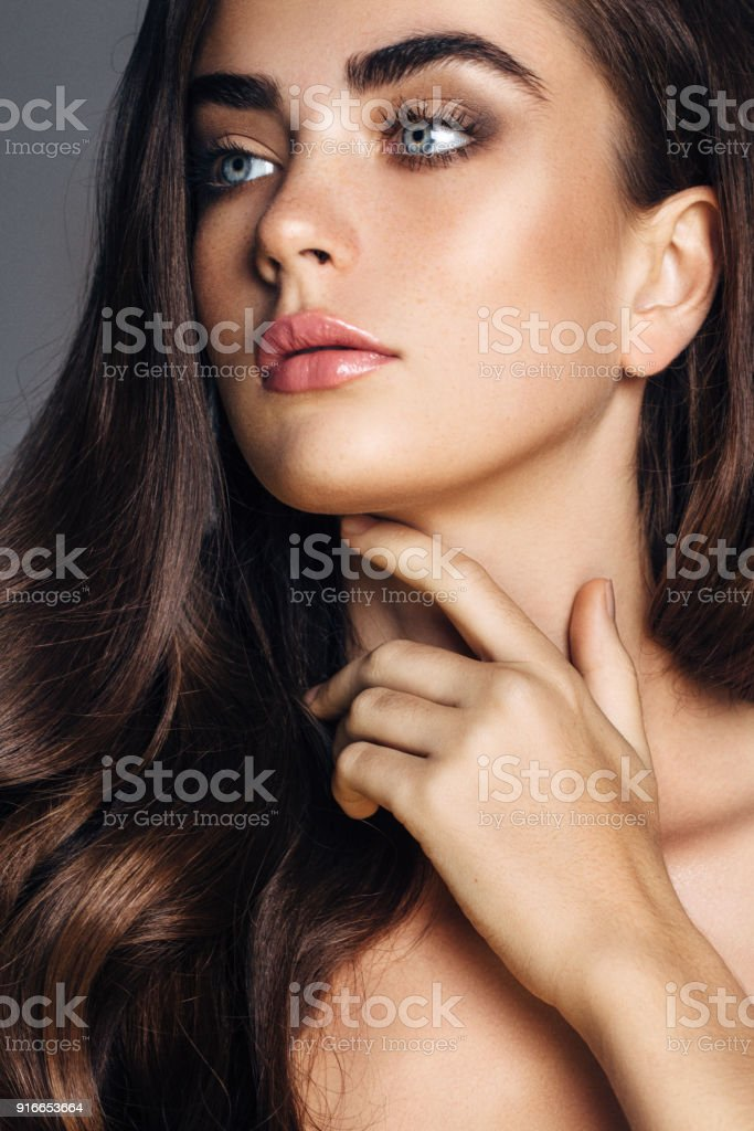 Beautiful woman with amazing curly long hair stock photo
