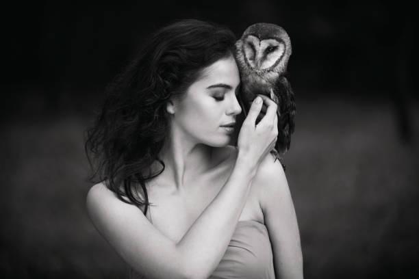 Beautiful woman with an owl picture id820769868?b=1&k=6&m=820769868&s=612x612&w=0&h=ex0p m80uvcte c9vun51zhwgnlft pvbgcwsbxcjje=
