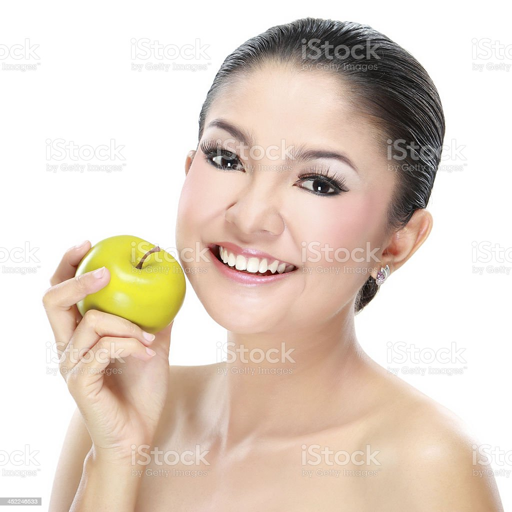 Beautiful woman with apple royalty-free stock photo