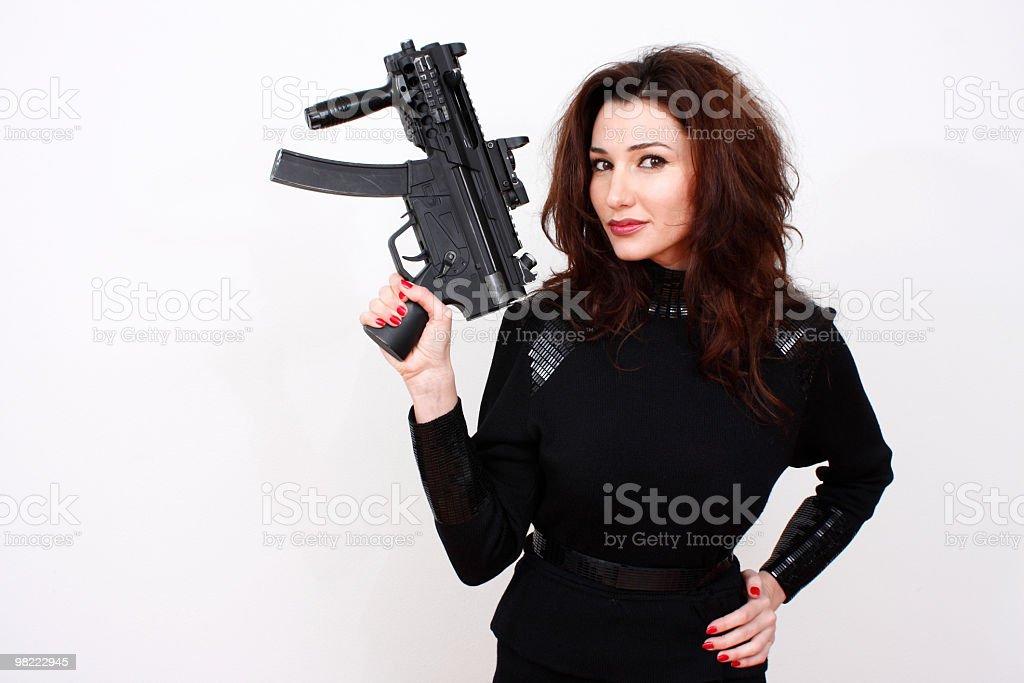 Beautiful woman with assault gun royalty-free stock photo