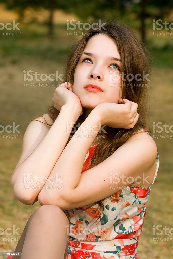 Beautiful woman with attractive eyes dreaming and looking up stock photo