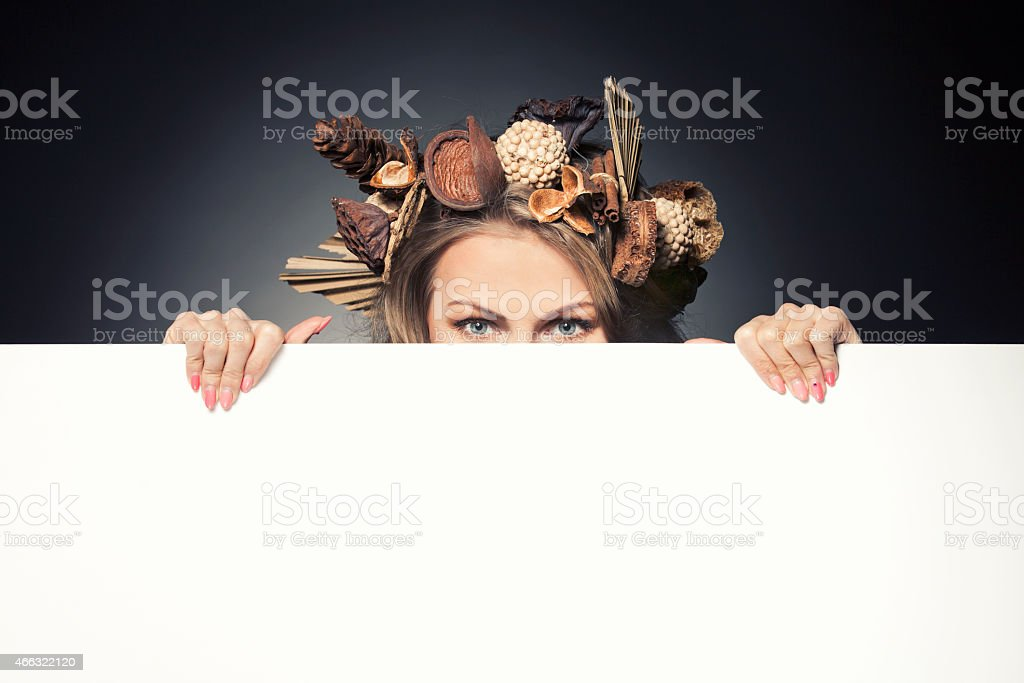 Beautiful woman with autumn wreath in hair stock photo