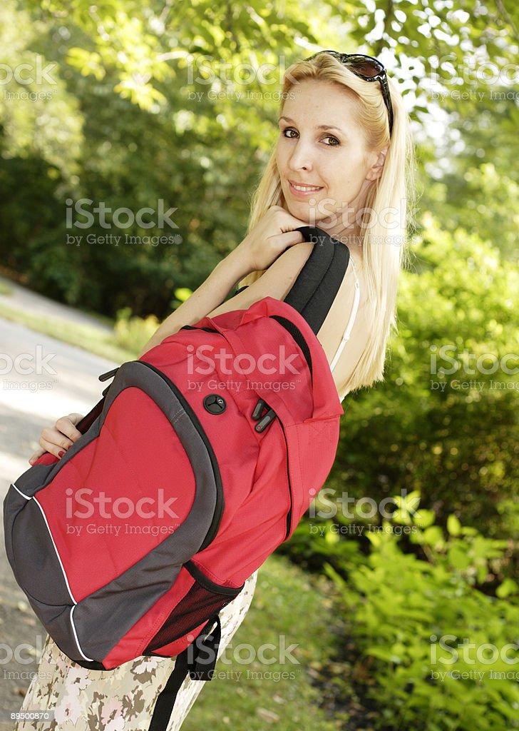 Beautiful Woman with Backpack royaltyfri bildbanksbilder
