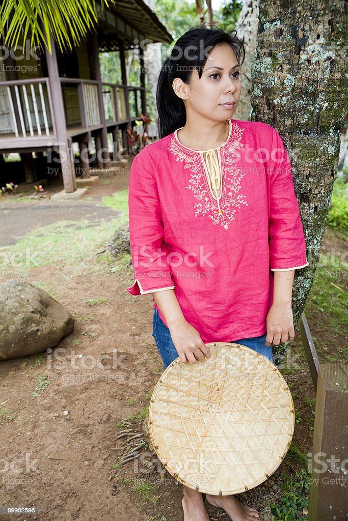 Beautiful Woman with Bamboo Hat royalty-free stock photo