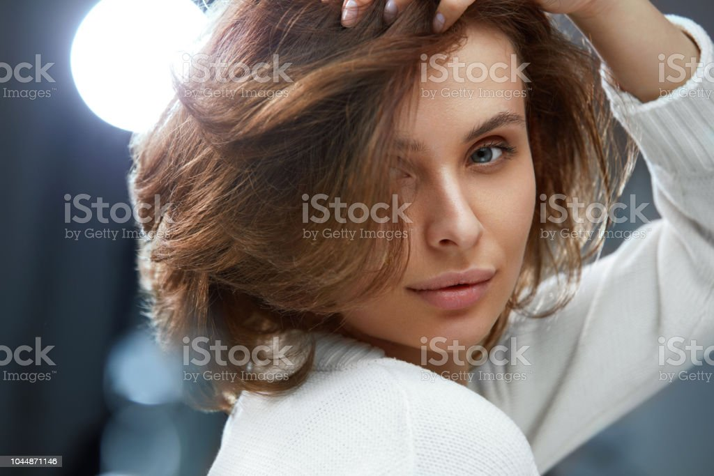 Beautiful Woman With Beauty Face, Short Hair And Natural Makeup Beautiful Woman With Beauty Face, Short Brown Hair And Natural Makeup. Portrait Of Girl With Bob Haircut And Fresh Healthy Skin. High Resolution Adult Stock Photo