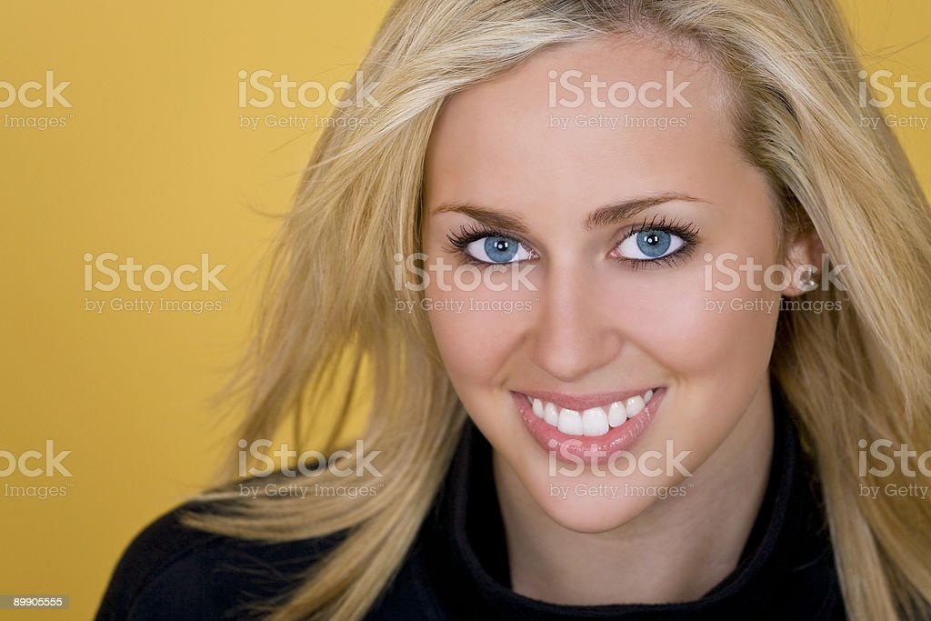 Beautiful Woman WIth Blond Hair and Blue Eyes Smiling royalty-free stock photo
