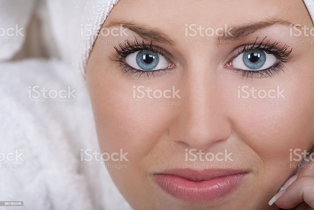 Beautiful Woman With Blue Eyes Wrapped In White Towel royalty-free stock photo