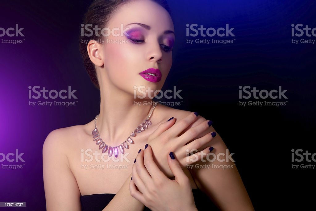 Beautiful woman with blue nails and creative makeup royalty-free stock photo