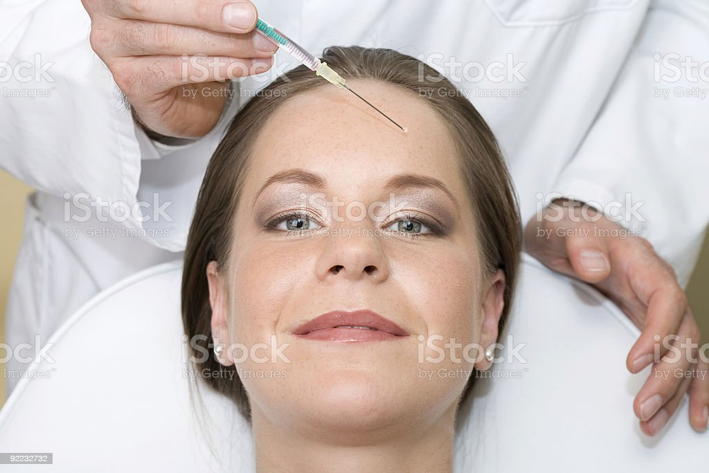 Beautiful woman with Botox injection royalty-free stock photo