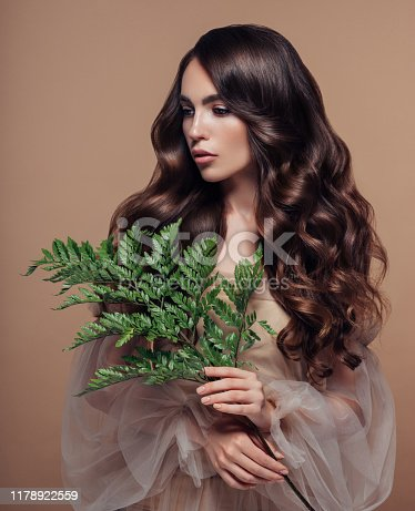 Beautiful woman with branch