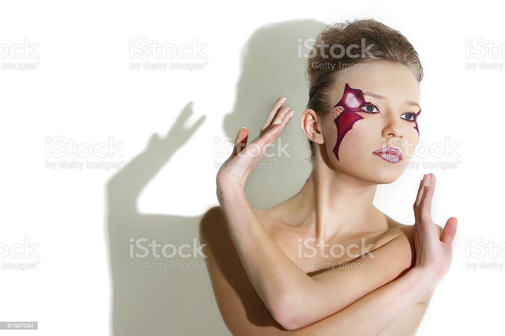 Belle femme avec art visage lumineux pour le visage photo libre de droits