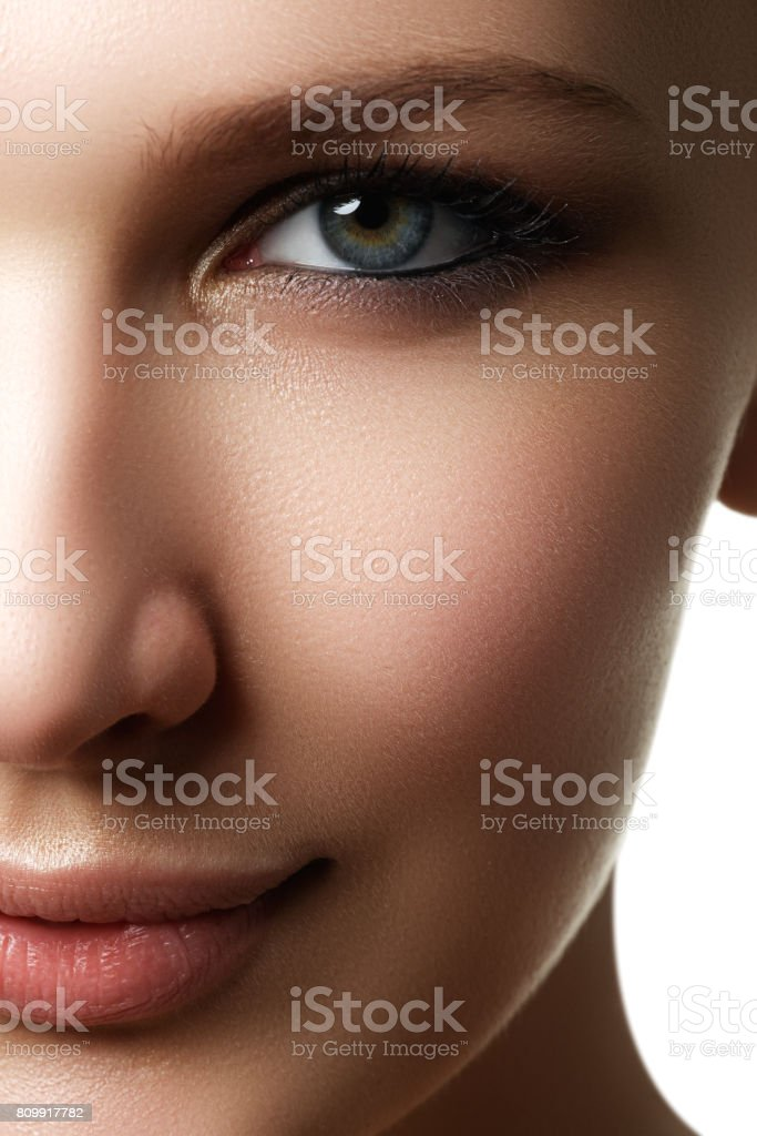 Beautiful woman with bright make up eye with sexy liner makeup. stock photo