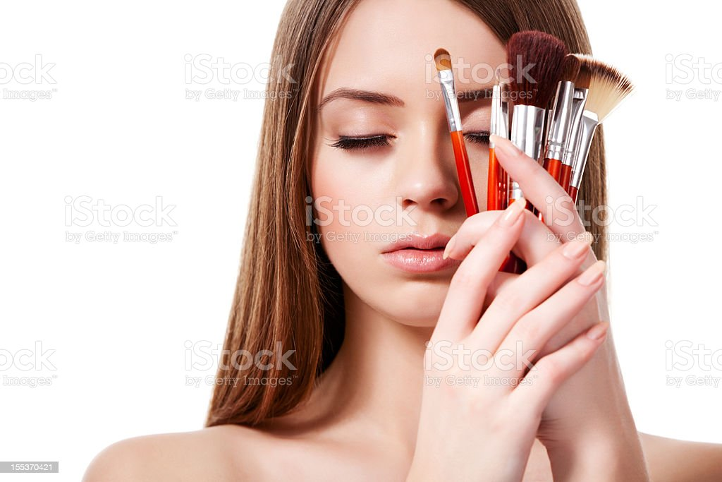 Beautiful woman with brushes royalty-free stock photo