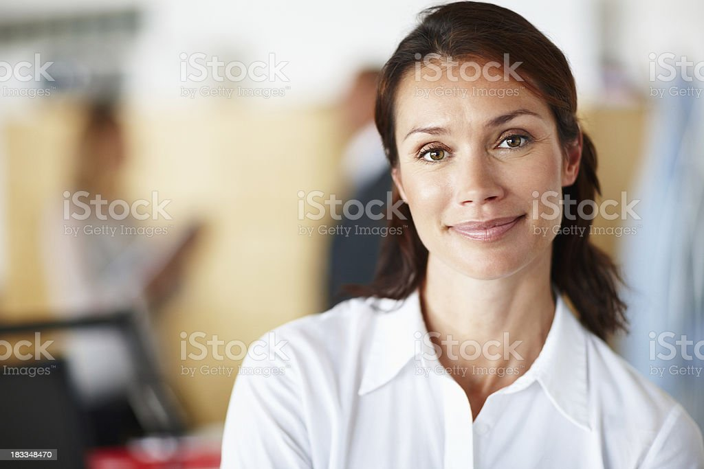Beautiful woman with business people in the background stock photo