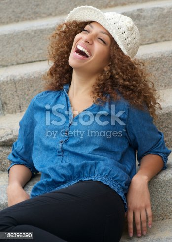 186534921 istock photo Beautiful woman with cheerful expression on face 186396390