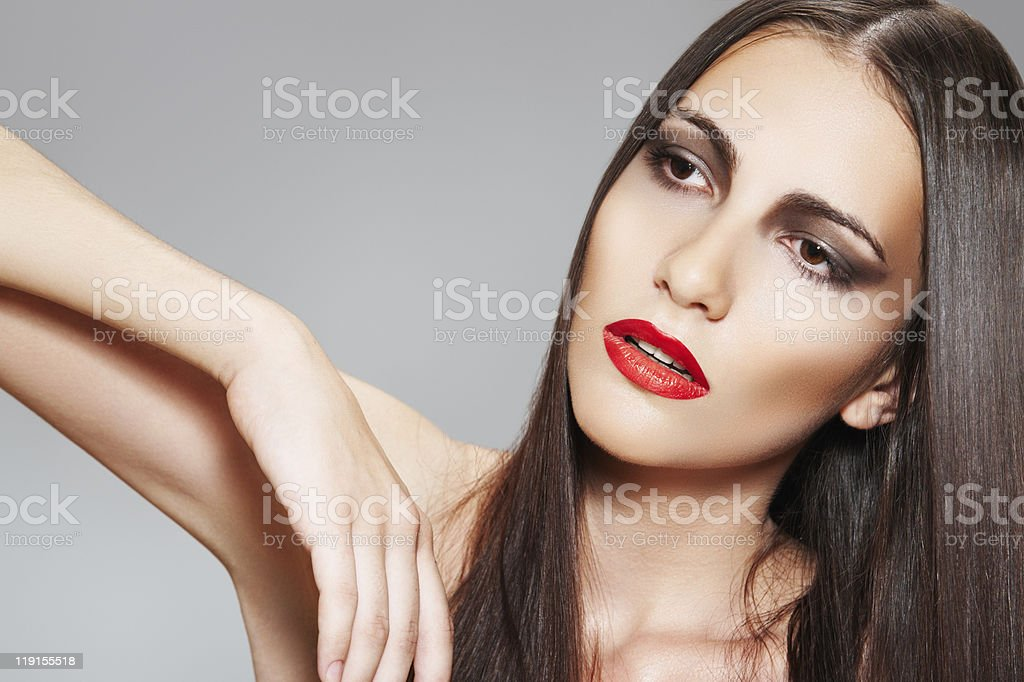 Beautiful woman with chic long hair, clean skin, red lips stock photo