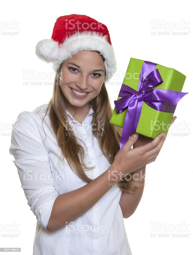 Beautiful woman with christmas hat has gift in hands royalty-free stock photo