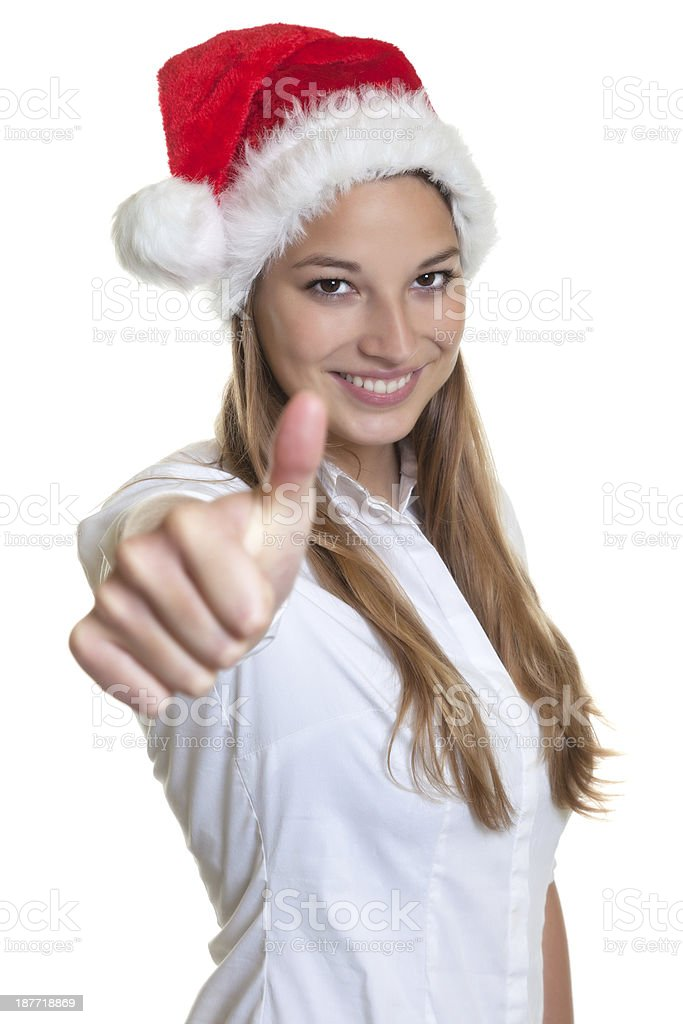 Beautiful woman with christmas hat showing thumb royalty-free stock photo