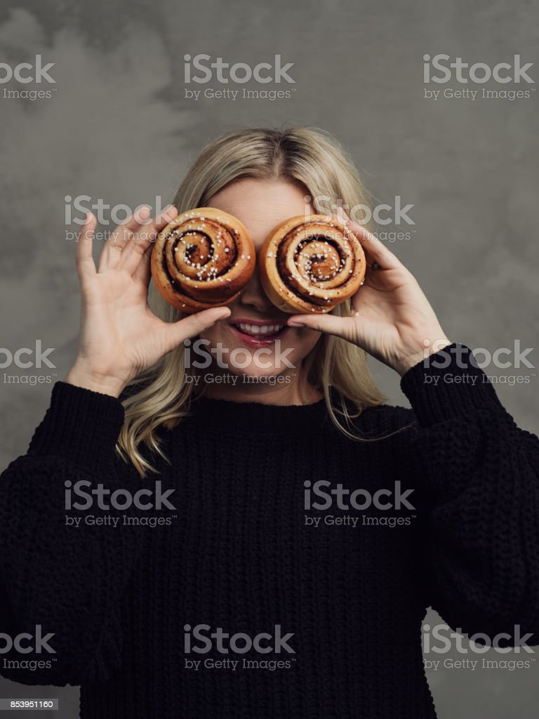 Beautiful woman with cinnamon buns stock photo
