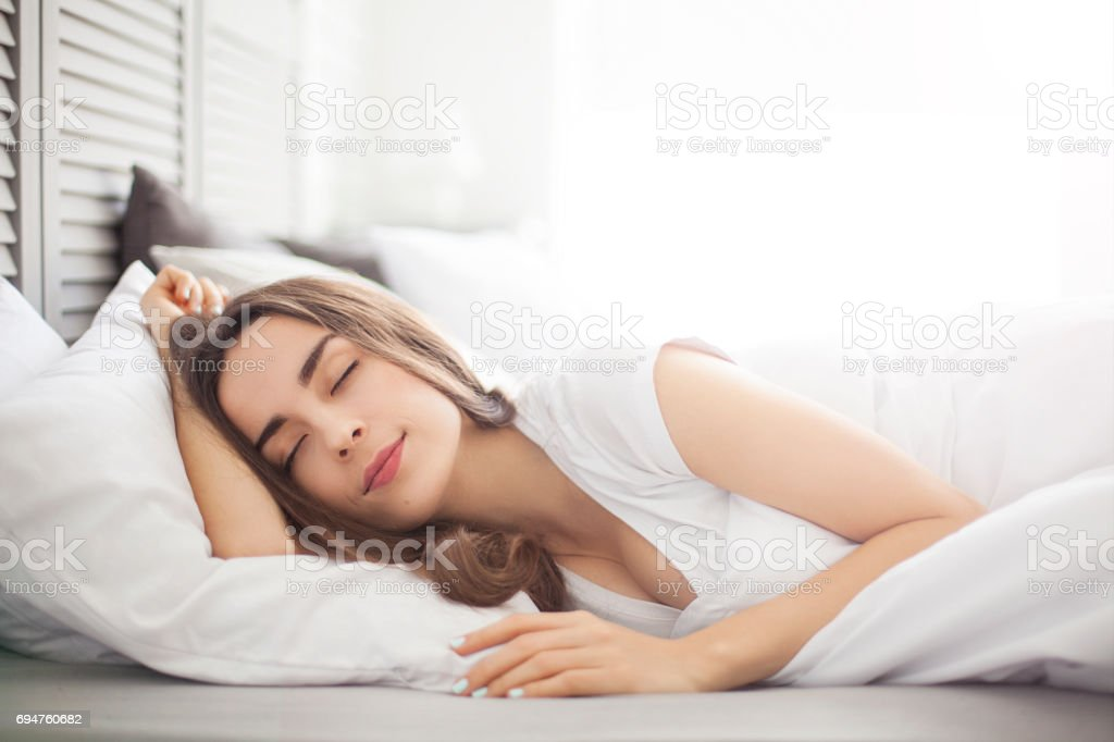 beautiful woman with closed eyes stock photo