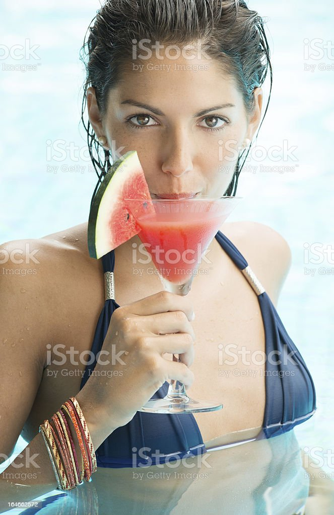 Beautiful Woman with cocktail at the Pool on Spring Break royalty-free stock photo