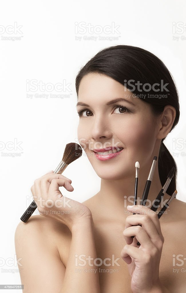 Beautiful woman with cosmetic brushes royalty-free stock photo