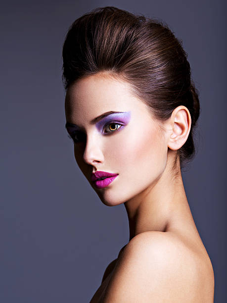 beautiful  woman with creative hairstyle and purple makeup - lila augen make up stock-fotos und bilder