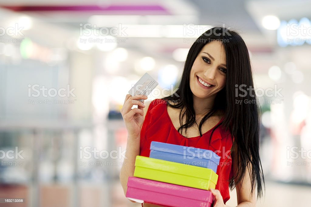 Beautiful woman with credit card in shopping mall royalty-free stock photo
