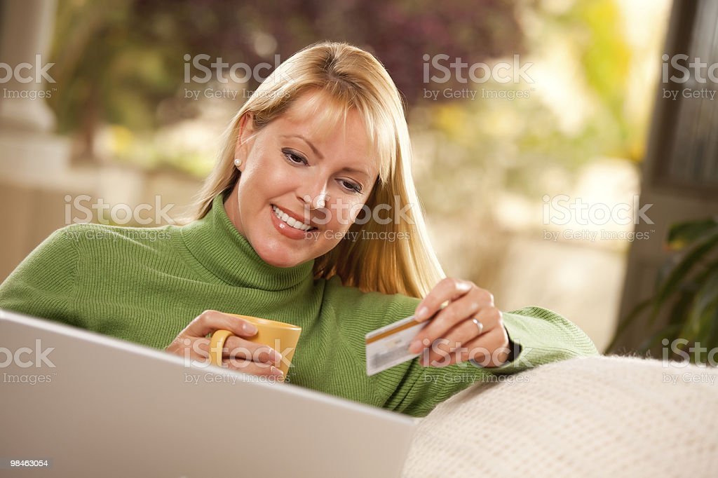 Beautiful Woman with Credit Card Using Laptop royalty-free stock photo